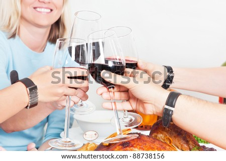 Group of people having some drinks together, celebrating, having fun - stock photo