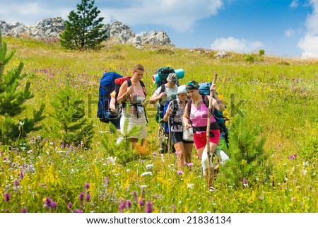 Group of people hikes in  Crimean mountains