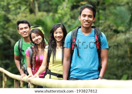 group of people hiking together. walking in the countryside - stock photo