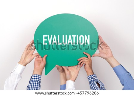 Group of people holding the EVALUATION written speech bubble - stock photo