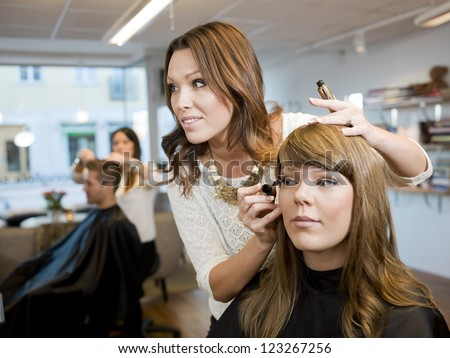 Group of people in a Beauty salon - stock photo