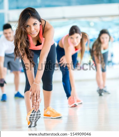 Group of people in a gym class - fitness concepts  - stock photo