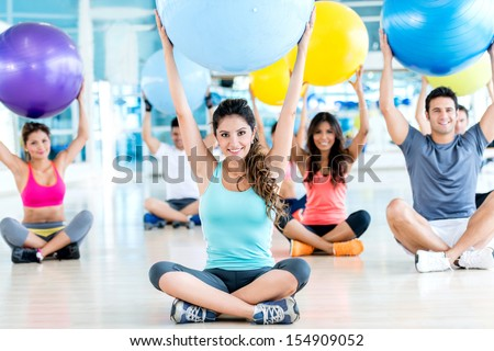 Group of people in a Pilates class at the gym