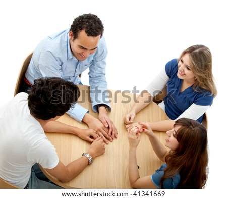 Group of people in a round table isolated over a white background - stock photo