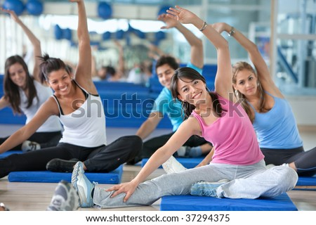 Group of people in a stretching class at the gym