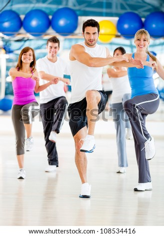 Group of people in an aerobics class at the gym