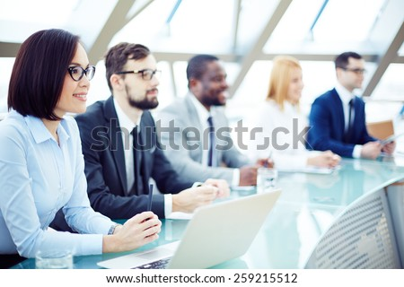 Group of people in conference hall - stock photo