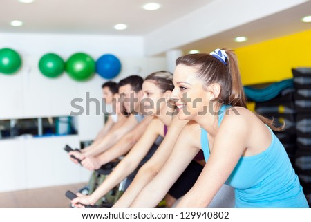 Group of people in the gym doing cardio training - stock photo