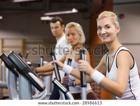 Group of people jogging in a gym - stock photo