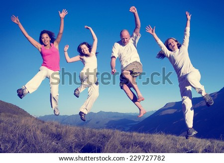 Group of People Jumping Happines Outdoors Concept - stock photo