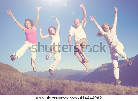 Group of People Jumping Outdoors Concept