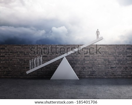 Group of people lifting a single person over a wall - team effort or inequality concept - stock photo