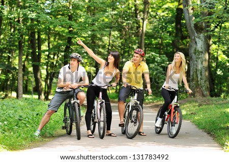 Group of people on a bicycles in a countryside - stock photo