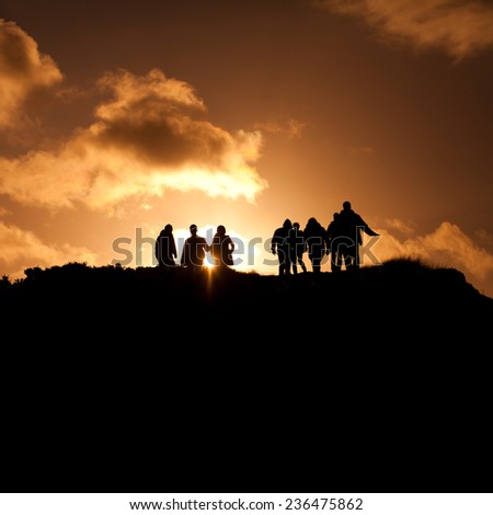 Group of people on a Scottish hill- Arthur Seat. Landscape view. Scottisch landscape. sunset, view, tourism, travelling, walking.