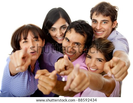 Group of people pointing at the camera and smiling - isolated - stock photo