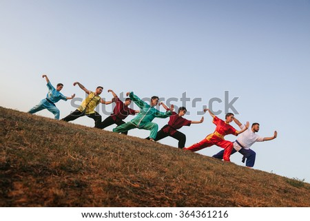 Group of People Practising Martial Arts Outdoors
