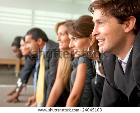 Group of people ready to race in a business competition in an office - stock photo