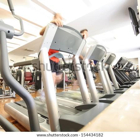 Group of people running on treadmills - stock photo