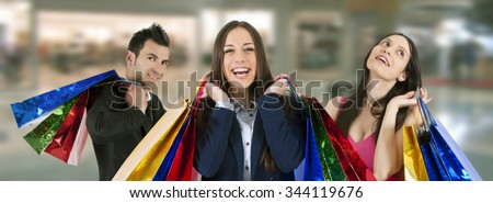 group of people shopping in shopping center - stock photo