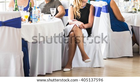 Group of people sitting at wedding tables