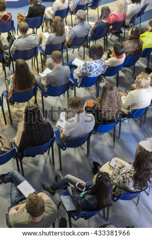 Group of People Sitting in Lines on the Meeting or Conference. Vertical Image Composition