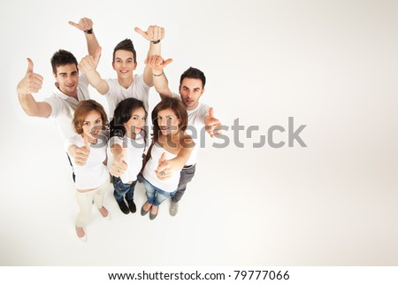 group of people smiling, approving at the camera - stock photo