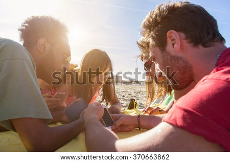 Group of people texting using their smartphone - concept about people, technology and lifestyle - stock photo