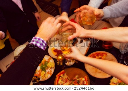 Group of people toasting at a celebration  - stock photo