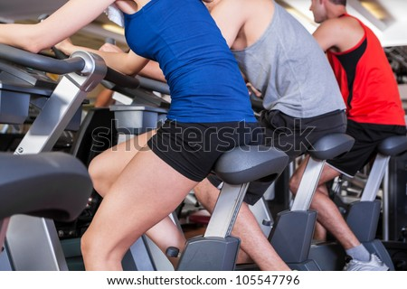 Group of people training in a fitness club - stock photo