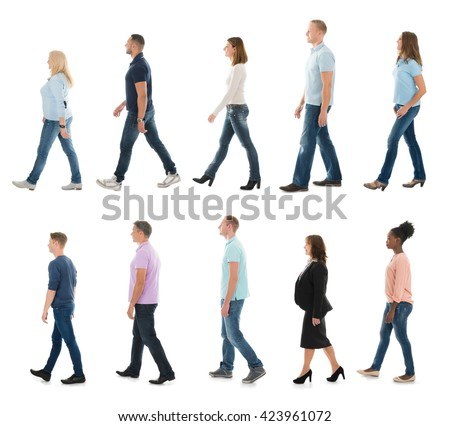 Group Of People Walking In Line Against White Background - stock photo