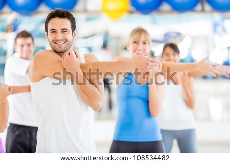 Group of people warming up at the gym - stock photo