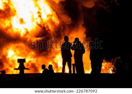 Group of people watching dangerous big fire