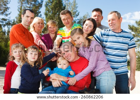 Group of people with children showing Unity - stock photo