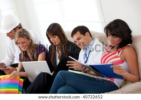 Group of people with different professions sitting on a sofa