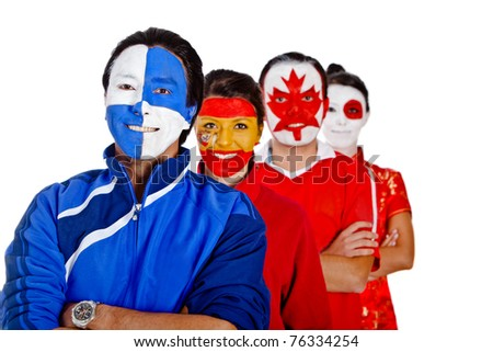 Group of people with flags of different countries painted on their faces - stock photo