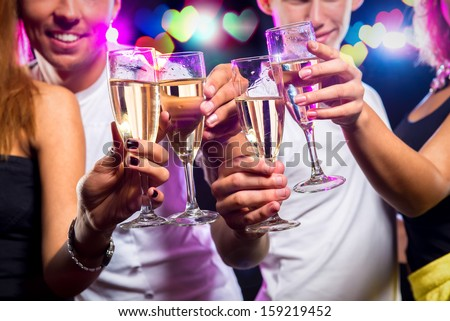 Group of people with glasses of sparkling champagne over abstract background  - stock photo
