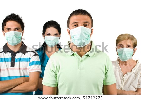 Group of people with protective mask standing with hands crossed and looking at you isolated on white background,this is a concept of protection from flu A-H1N1 - stock photo