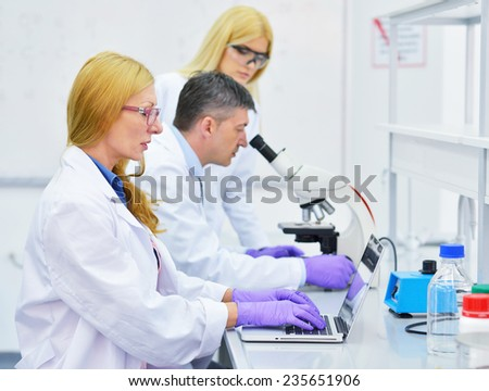 group of people working in the laboratory
