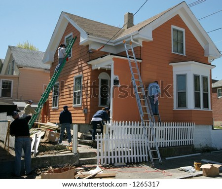 group of people working together to renovate house - stock photo