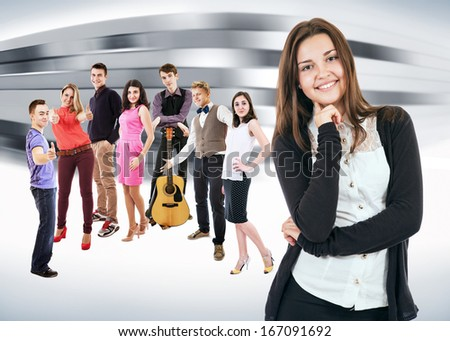 Group of positive expression students on abstract modern building background - stock photo