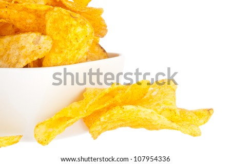 Group of potato chips in a white bowl isolated on white background (with clipping path)