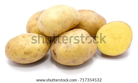 Group of potatoes and a half isolated on white background