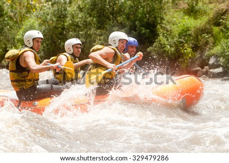Group Of Powerful Young Men On A Rafting Boat Patate River Ecuador Shoot From Water Level
