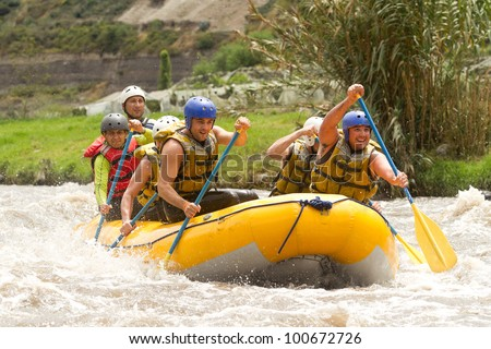 Group of powerfull young men on a rafting boat. Patate river , Ecuador. - stock photo