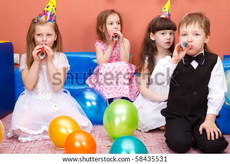 Group of preschool kids at the birthday party - stock photo