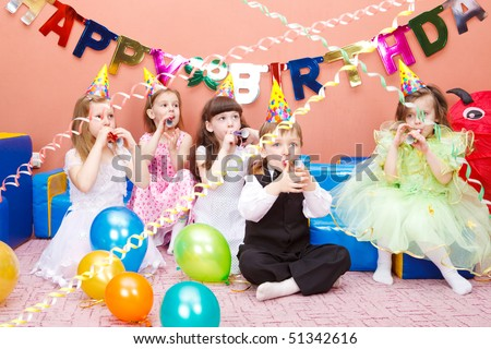 Group of preschool kids with the party horns - stock photo