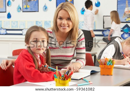 Group Of Primary Schoolchildren And Teacher Having lesson In Classroom - stock photo