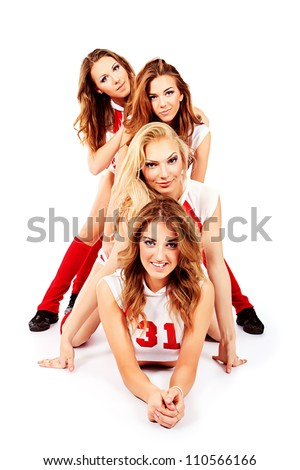Group of professional cheerleaders posing at studio. Isolated over white. - stock photo