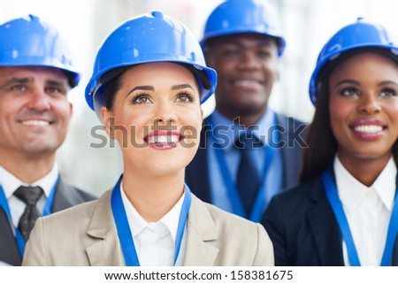 group of professional construction managers looking up