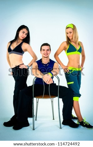 group of proud fitness instructors on white background - stock photo